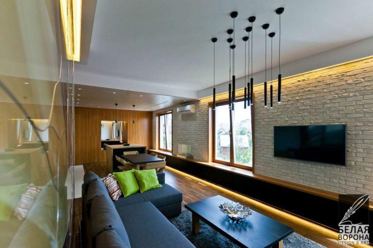 Мебель в интерьере современной гостинной совмещённой со столовой