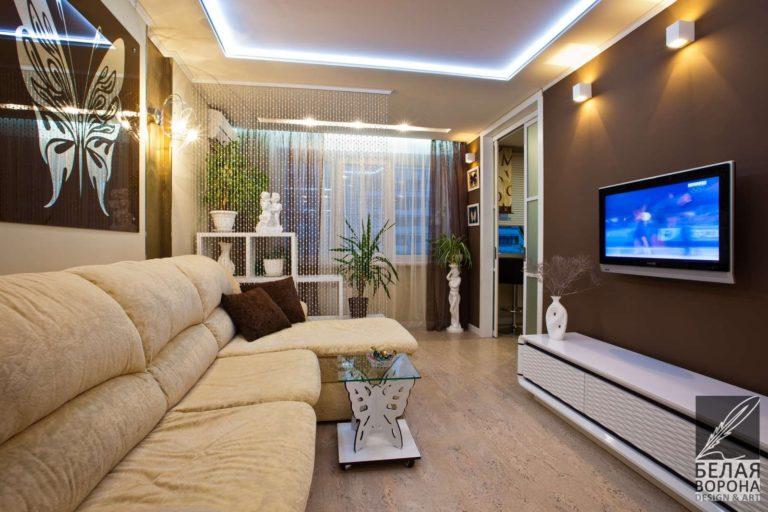 дизайн интерьер гостиной в с применением золотистых элементов