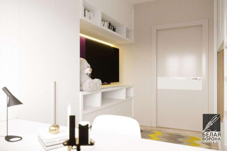 Светлая встроенная мебель и яркме цветовые акценты в детской комнате