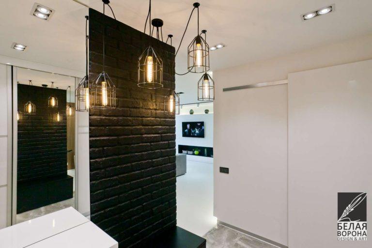 дизайн интерьер прихожей в с применением резкого контраста и дизайнерских осветительных приборов